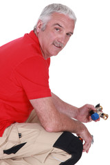 Man with a piece of plumbing