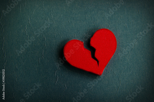 red broken heart shape, on textured blue