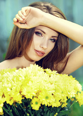 Beautiful woman among spring blossom.