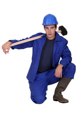 Young construction worker on white background