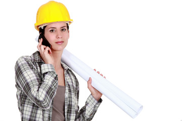 Female foreman with plans and mobile
