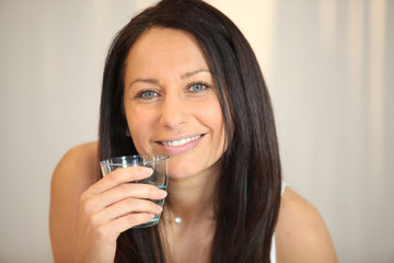 Brunette with glass of water