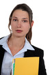 Brunette administrator holding yellow folder