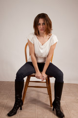 woman sitting in chair and looking at the camera