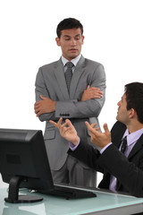 Boss having a discussion with his defensive employee