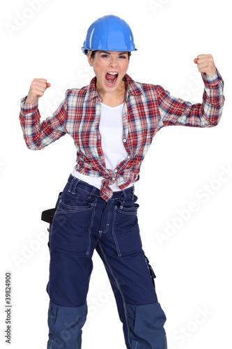 Cheering construction worker