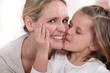 little girl kissing woman
