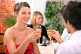 Couple with champagne glasses in restaurant