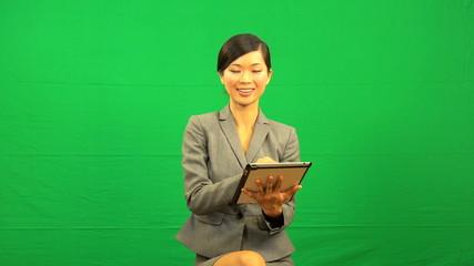 Asian Female Doctor Wireless Tablet Green Screen