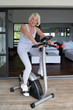 Older woman using an exercise bike