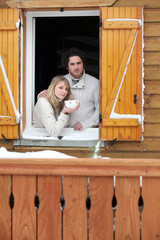 Couple staying in wooden chalet
