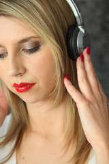 Blond woman listening to music