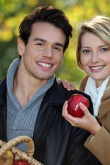 Couple out picking apples