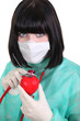 Surgeon listening to a heart's heartbeat