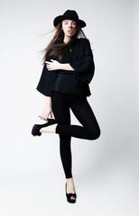 Fashion portrait of romantic beauty woman in black hat