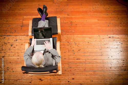 Businessman working on armchair