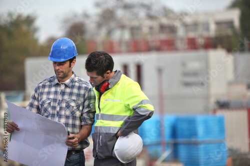 Two site workers sticking to the plans