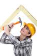 Tradeswoman hammering a frame