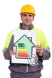 worker holding a trowel, an energy efficiency rating sign