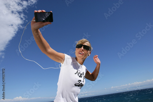 Woman jogging by the coast