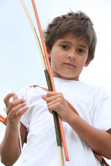 Young boy with bow and arrow