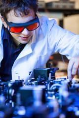 scientist doing research in a quantum optics  lab (shallow DOF;
