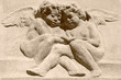 vintage image of two  angels  carved in clay