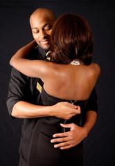 black couple, him unzipping her dress