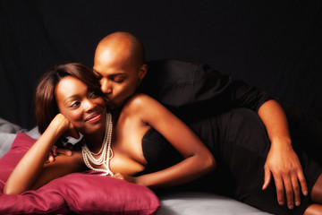 Romantic black couple, reclining  together