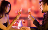 Couple with glasses of champagne on date