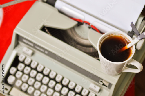 Retro postcard with typewriter and coffee