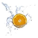Fototapety Orange juice splashing isolated on white