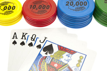 playing cards and gambling chips on white background