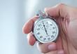 Leinwanddruck Bild - Human hand holding stopwatch