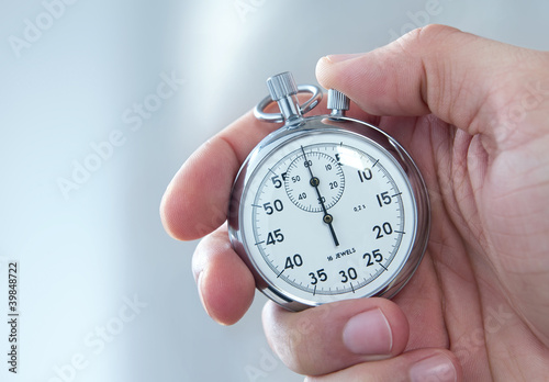 Human hand holding stopwatch