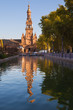 Plaza de España in Sevilla, Spain. Tower reflected in the canal
