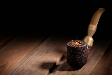Wooden Pipe and Tobacco