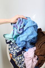 Woman Pile of dirty laundry washing