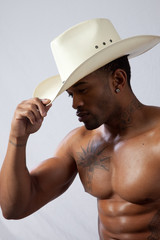 Strong black man in western hat