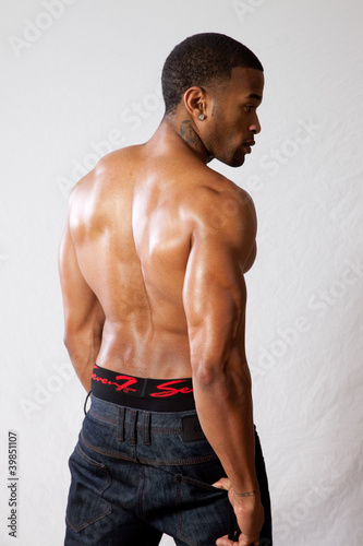 strong man toopless, showing his back