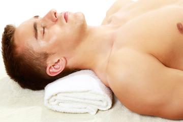 Young smart male enjoying massage