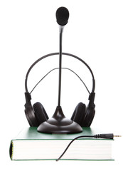headset with a microphone, hardcover book  isolated
