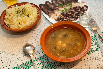 Russian cuisine: mushroom soup,  sauerkraut, meat and vodka.