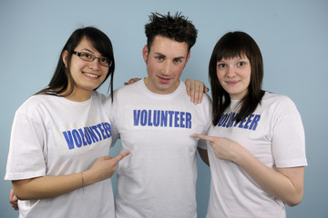 three happy young volunteers