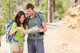 Fototapety Hiking - hikers looking at map