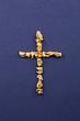 Kreuz aus Goldnuggets
