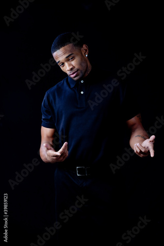 black man in black shirt , posing a question