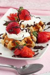 Strawberry waffles with cream