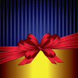 red gift ribbon bow on gold and blue background
