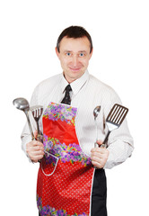Man in the apron holds kitchen accessories